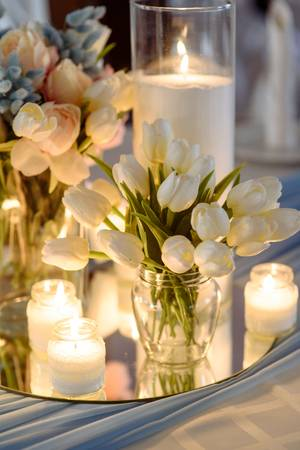 84730659-wedding-decorations-fresh-spring-tulips-and-candles-in-glasses-covered-festive-table-bride-idea-